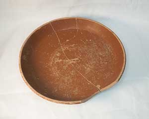 Roman farmers dined off this dish in one of the houses. This is Samian ware, which was mass-produced in Gaul (modern France) and exported throughout the Roman Empire. This bowl has the name of the potter stamped in the centre.